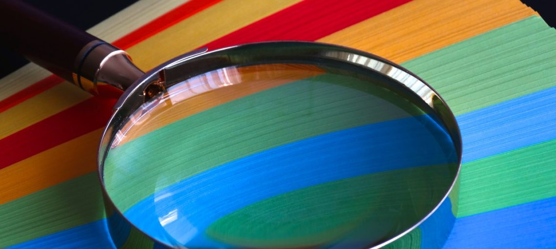 color spectrum and magnifying glass