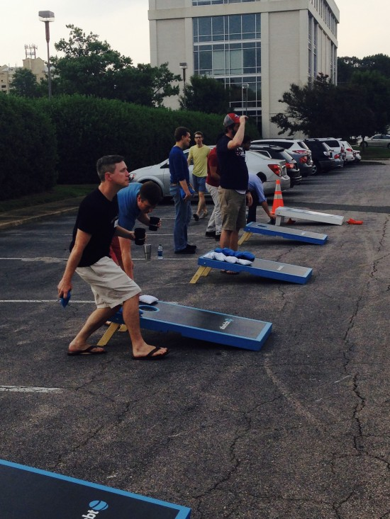AtlanticBT employees playing corn hole 11