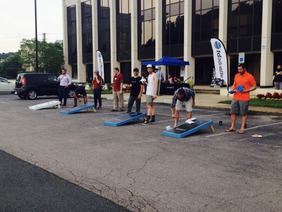 AtlanticBT employees playing corn hole 10