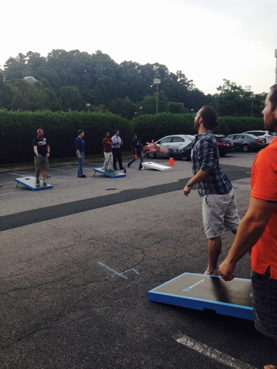 AtlanticBT employees playing corn hole 9