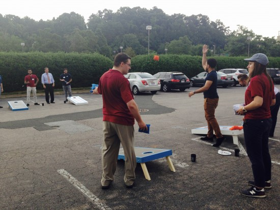 AtlanticBT employees playing corn hole 8