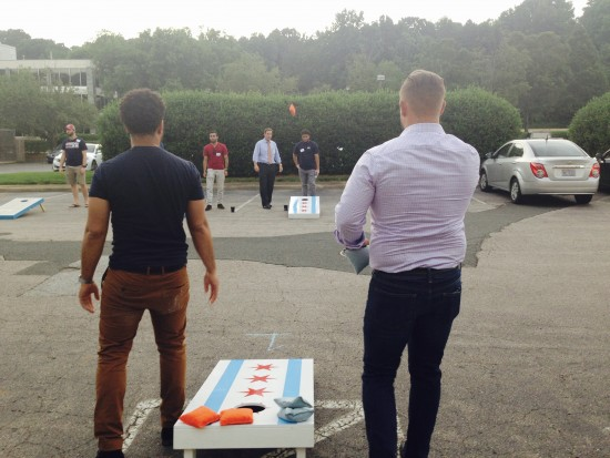 AtlanticBT employees playing corn hole 7