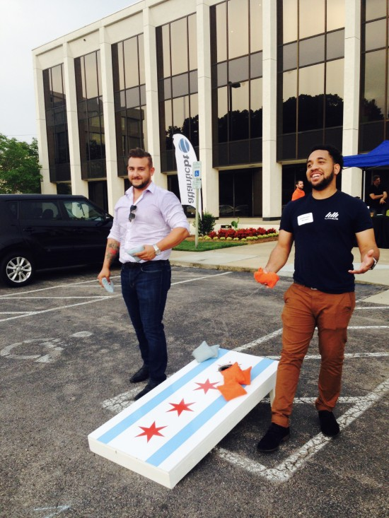 AtlanticBT employees playing corn hole 2