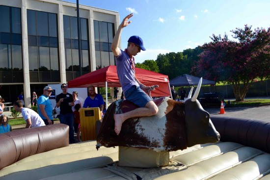 side shot of AtlanticBT employee on mechanical bull