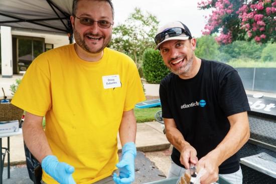 Doug and Matt cooking burgers