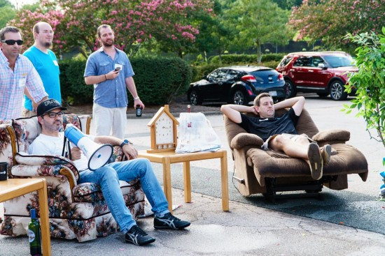 AtlanticBT employees sitting in chairs as water balloon targets
