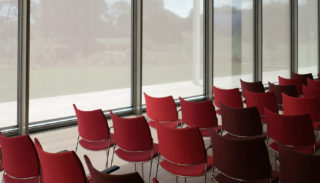 Conference room with red chairs