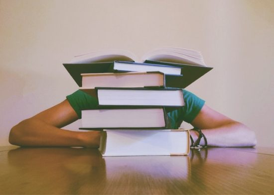 Student studying too many books