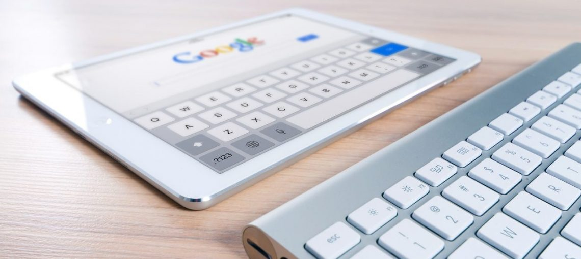 White tablet with Google onscreen and keyboard