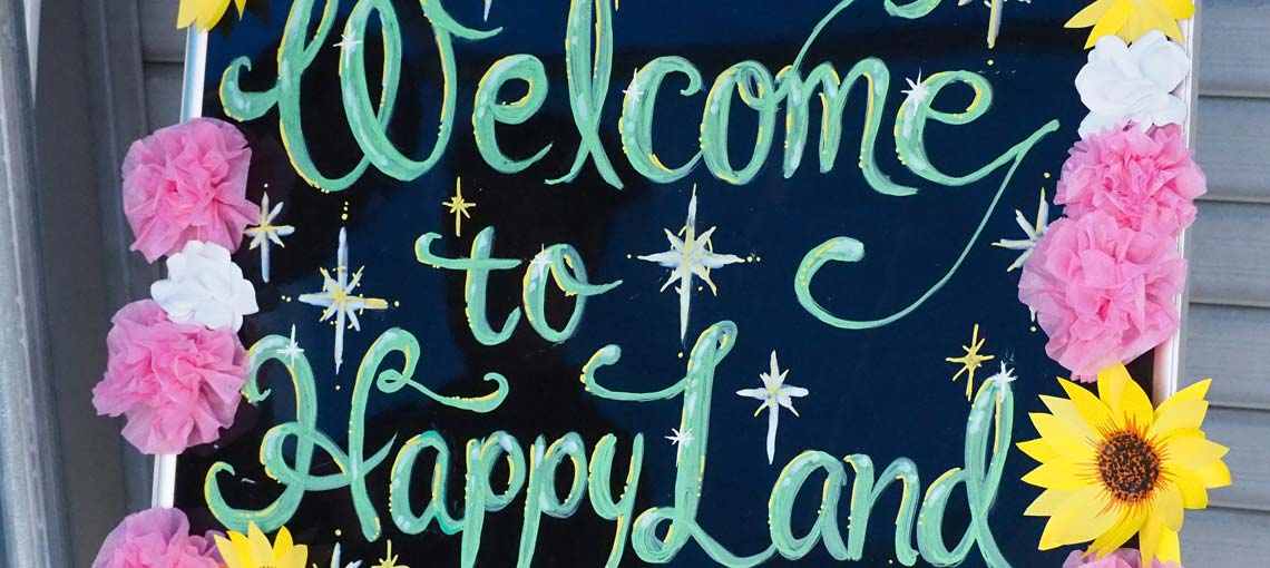 Sign that reads Welcome to Happy Land